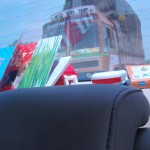 My toys & books arranged in the back of car